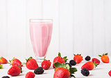 Milkshake glass with fresh summer berries smoothie
