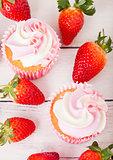 Cupcake muffin with strawberry cream dessert