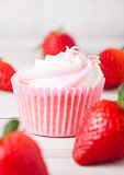 Cupcake muffin with strawberry cream dessert