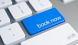 Book Now - Text on the Blue Keyboard Button. 3D.