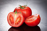 Tomatoes On A Glass Background