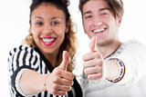 Two young cheerful people giving thumbs up