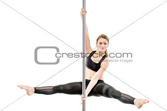 flexible athlete with a good stretch with a twine on the pylon o