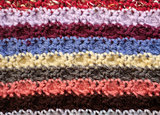 Horizontal stripes of coloured crochet stitches background