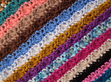 Diagonal stripes of crocheted stitches in multi-coloured wool ba