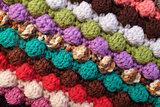 Multi-coloured crochet bobble stitches diagonal stripes backgrou