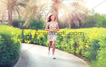 Pretty woman running in the park