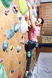 woman climber climbs indoors