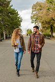 Young couple walking in the city park