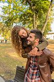 Beautiful long haired girl hugging her boyfriend