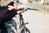 young cyclist man using a smartphone