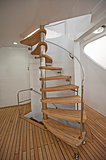 Wooden curved sprial staircase on sundeck of luxury yacht