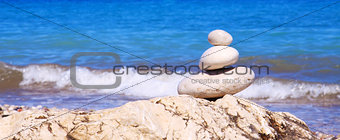 Spa stones balance on beach.
