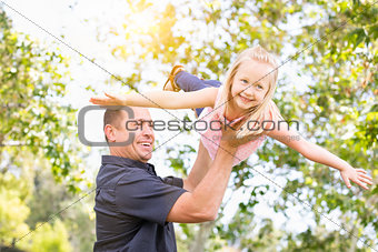 Young Caucasian Father and Daughter Having Fun At The Park