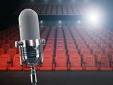 Vintage microphone on the stage of concert hall or theater with