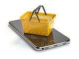 Mobile phone or smartphone with yellow shopping basket. Online s