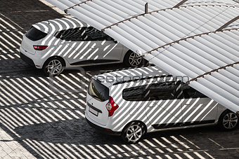 Cars on a parking lot under the shadow