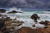 stormy skies over rugged coastline