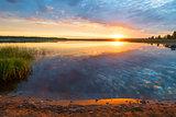 beautiful scenic lake at dawn, photo in orange color