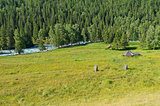 Abandoned cattle-ranch at the riverside. Altai Mountains, Russia