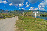 A road sign with the name of the village.  Altai, Russia.