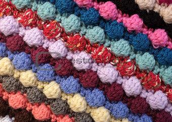 Diagonal stripes of multi-coloured bobble crochet stitches backg