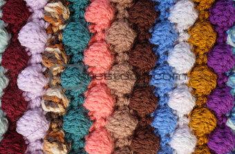 Vertical bobble crochet stitches, multi-coloured wool striped ba