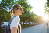 portrait of a young attractive woman with city backpack