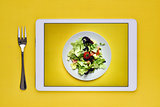 green salad in a digital tablet