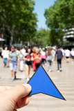 man with a blue arrow in Las Ramblas, Barcelona