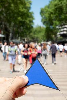 man with a blue arrow in Las Ramblas, Barcelona