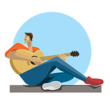 Caucasian musician sitting with the guitar in hands. Hipster man playing the acoustic guitar.