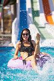 smiling lady in bikini sitting in the pool on rubber ring