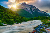 Sun is setting over the mountains and Fitz Roy river at Los Glac
