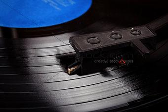 Turntable stylus on a vinyl record