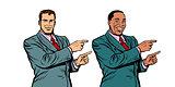 white and black businessman pointing finger sideways