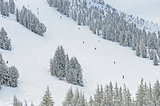 Skiers and Snowboarders on ski resort slopes
