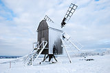 Snow covered traditional old windmill
