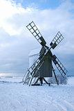 Old wooden windmill by winter season
