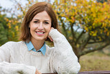 Attractive Happy Middle Aged Woman Resting on Fence