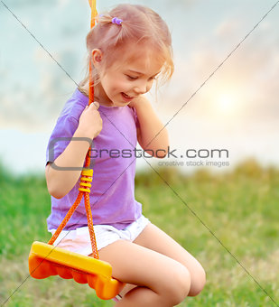 Cute baby girl on the swing