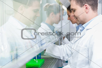 Researchers in science lab preparing samples