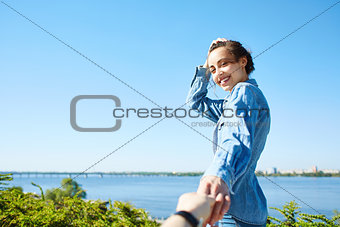 young attractive woman on the blue sky background