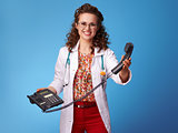 happy paediatrician doctor with phone on blue