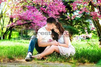 Cuddling couple. Couple in love. Love couple. Love hug. Love kiss. Couple kiss