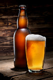 Beer on wooden background
