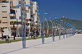 An arc of elegant street lamps on the Martil promenade. Morocco. Africa.