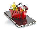Smartphone and shopping basket with  food and drink. Online groc