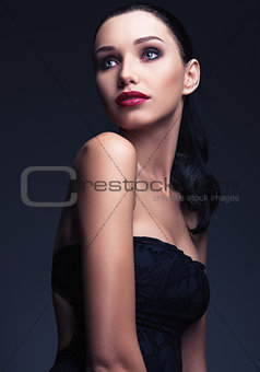 Studio fashion shot: portrait of lovely young woman