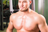 Portrait of muscular mixed race man in gym